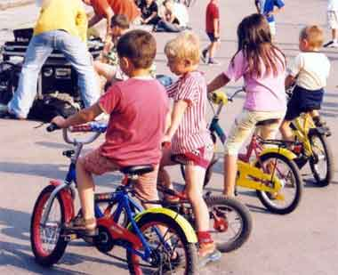 a bunch of kids riding bicycles